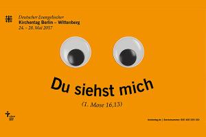 Die Werbung für den nächsten evangelischen Kirchentag präsentiert sich in grellem Orange und mit großen Kulleraugen.